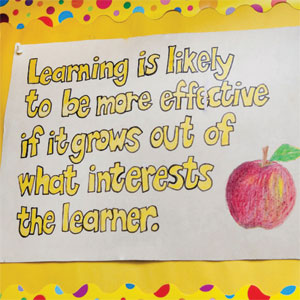hand drawn poster with quote and apple